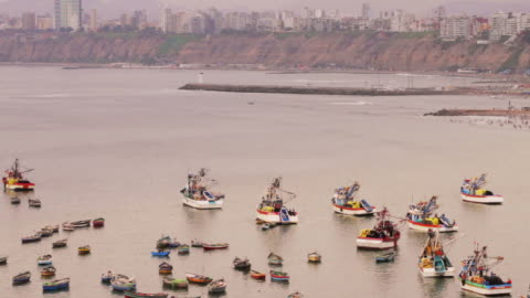 stockvideo's en b-roll-footage met colorful peruvian fishing boats in harbor - fishing industry