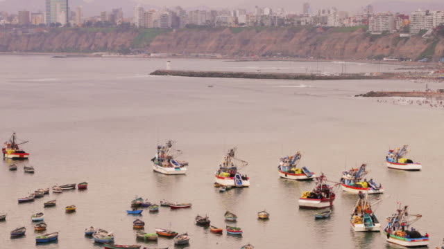 colorful peruvian fishing boats in harbor - fishing industry stock videos & royalty-free footage