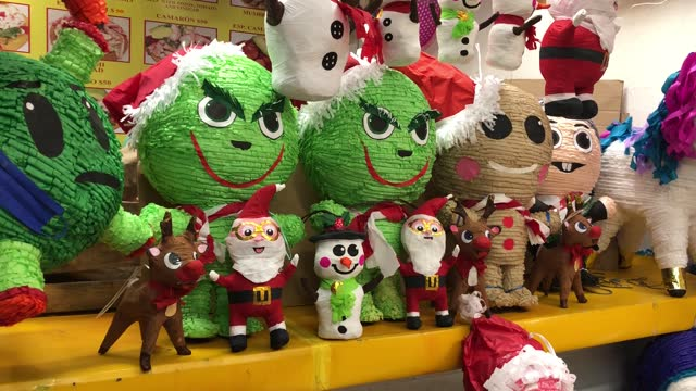 colorful pinatas depicting christmas fathers and snowman are for sale at a market stall in the picturesque coyoacan neighborhood as the holiday... - papier stock videos & royalty-free footage