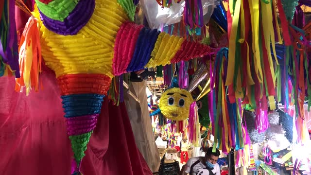 colorful pinatas hang on a market stall in the picturesque coyoacan neighborhood as the holiday season approaches on december 12, 2020 in mexico... - papier stock videos & royalty-free footage
