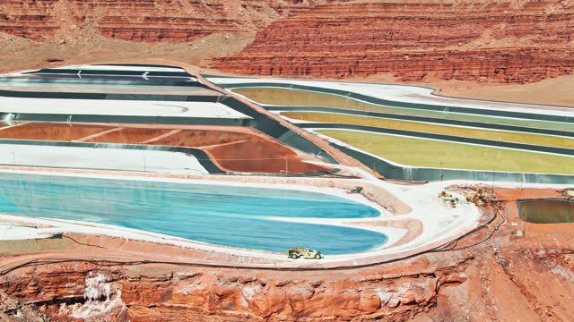 colorful potash mine amid red rocks near moab, utah - aerial - mining stock videos & royalty-free footage