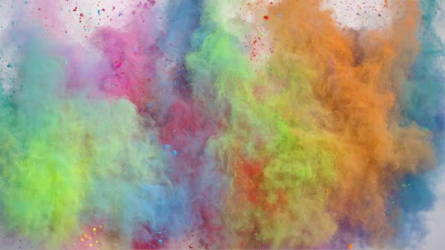 vídeos de stock e filmes b-roll de colorful powder explosion - multi coloured