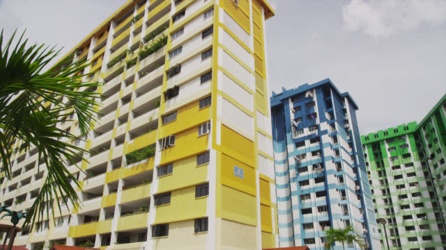 colorful public housing near bugis village - flat stock videos and b-roll footage