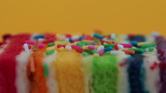 colorful rainbow cake - icing stock videos and b-roll footage
