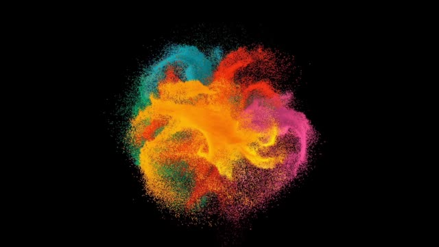 colorful rainbow holi paint color powder explosion isolated at black background - colors stock videos & royalty-free footage
