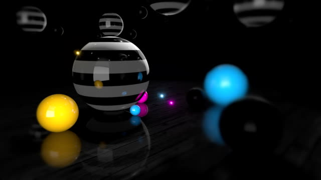 Colorful Reflective Spheres Slowly Rotating On A Wooden Floor