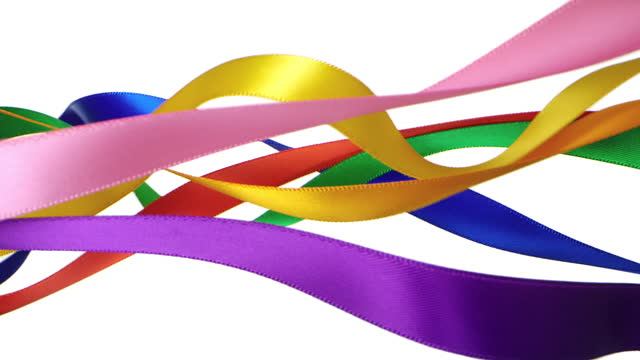7 colorful ribbons on white background, for celebration events and party for new year, birthday party, christmas or any holidays, waiving and curling in super slow motion and close up - anniversary stock videos & royalty-free footage