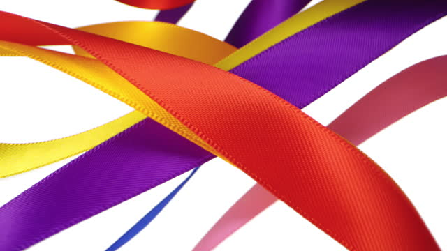 7 colorful ribbons on white background, for celebration events and party for new year, birthday party, christmas or any holidays, waiving and curling in super slow motion and close up - banner sign stock videos & royalty-free footage