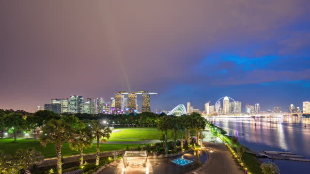 colorful skyline of singapore, day to night time lapse video - river singapore stock videos & royalty-free footage