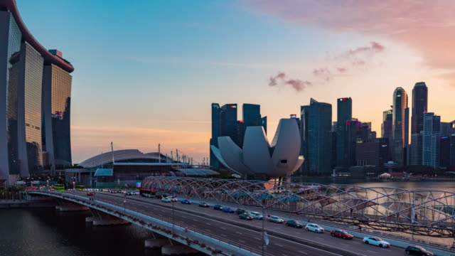 colorful skyline of singapore, day to night time lapse video - singapore river stock videos & royalty-free footage