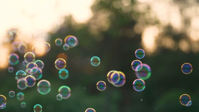 colorful soap bubbles flying outdoors - large group of objects stock videos & royalty-free footage