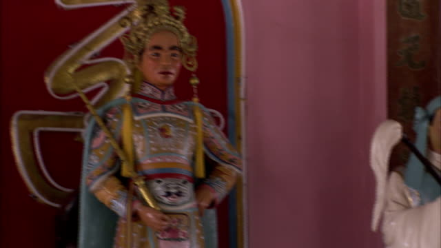 colorful statues in cao dai temple depict notable figures. - tay ninh stock videos & royalty-free footage