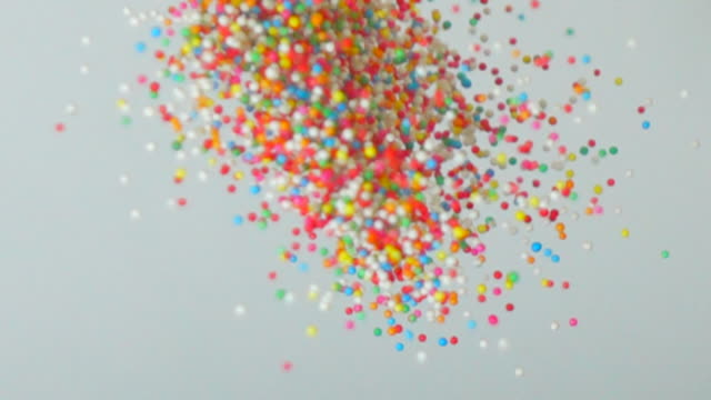 colorful sugar candy balls in slow motion - pouring stock videos & royalty-free footage