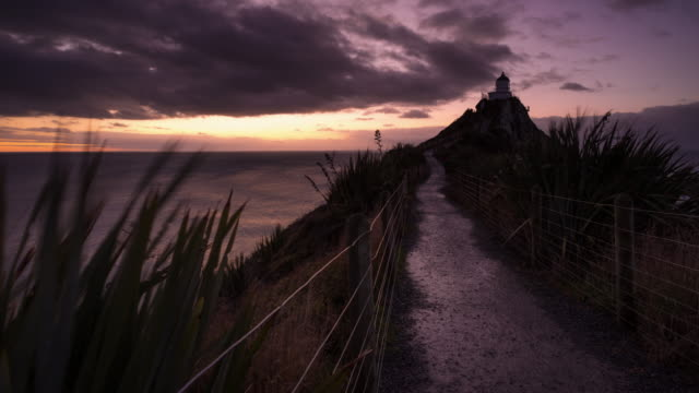 Colorful Sunrise Timelapse at Nugget Point Lighthouse.