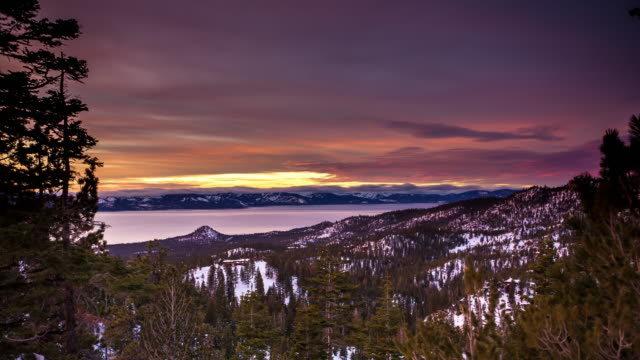 colorful sunset at lake tahoe - day to dusk stock videos & royalty-free footage