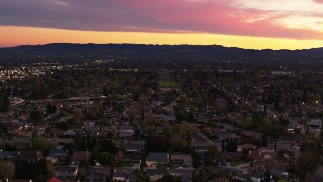 colorful sunset in northridge, los angeles - aerial establisher - northridge stock videos & royalty-free footage