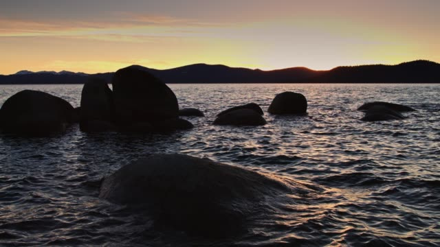 colorful sunset over lake tahoe - state park stock videos & royalty-free footage