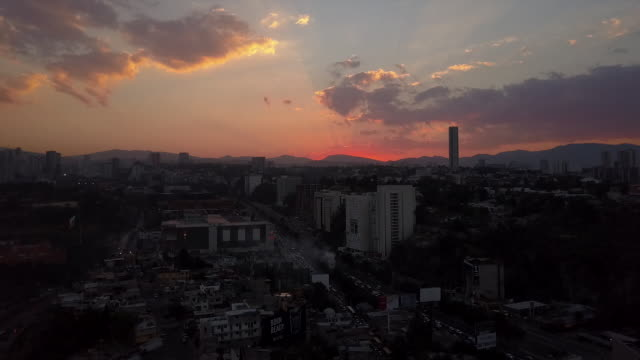Colorful sunset over Mexico City, wide aerial