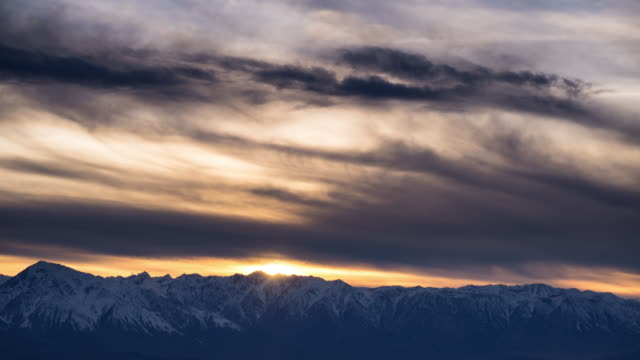 colorful sunset over white mountains, california - snowcapped mountain stock videos and b-roll footage
