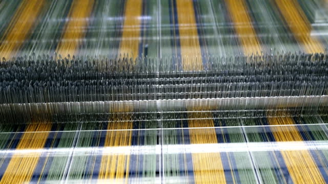 colorful threads on a loom in  weaving loom machine in textile factory - textile mill stock videos & royalty-free footage