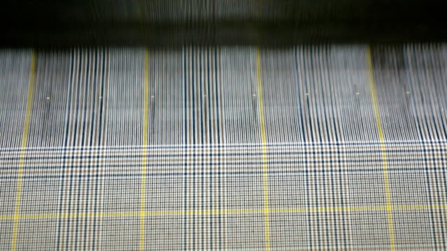 colorful threads on a loom in  weaving loom machine in textile factory - ball of wool stock videos & royalty-free footage