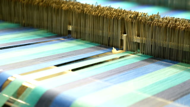 colorful threads on a loom in weaving machine - textile industry stock videos & royalty-free footage