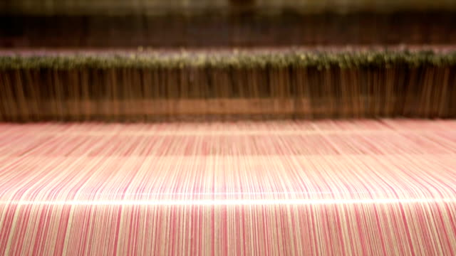 colorful threads on a loom in weaving machine - loom stock videos & royalty-free footage