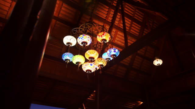 colorful turkish mosaic glass lamps and lanterns indoors at twilight room. - mosaic stock videos & royalty-free footage