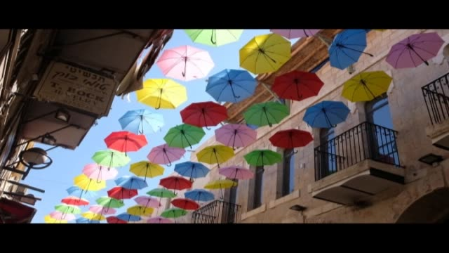 colorful umbrellas in yoel solomon street on july 20 2018 in central jerusalem - full frame stock videos & royalty-free footage