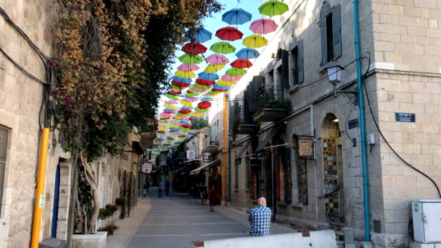 colorful umbrella's line yoel solomon shops near jaffa street in downtown jerusalem. - alley stock videos & royalty-free footage