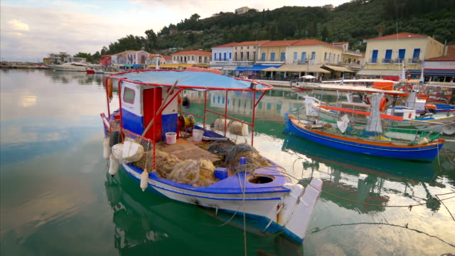 colorful wooden fishing boats docked in katakolon, greece - cultura mediterranea video stock e b–roll