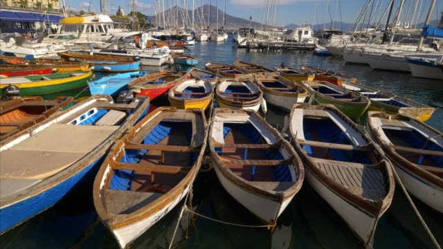 colorful wooden rowboats moored in marina, naples, italy - bay of water stock videos & royalty-free footage