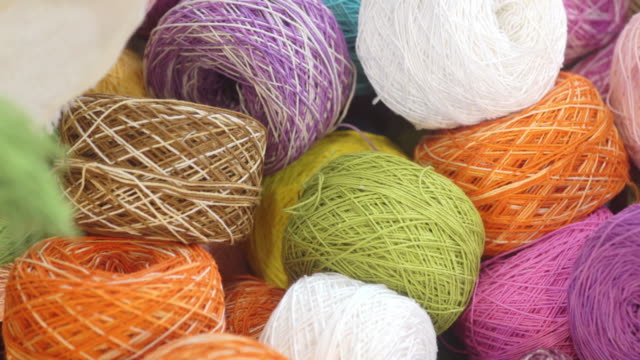 colorful yarn balls of wool thread for knitting in the basket. - ball of wool stock videos & royalty-free footage