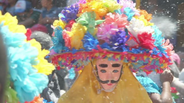 colorful zoque coiteco carnival parade at chiapas village. mexican syncretism tradition - papier stock videos & royalty-free footage
