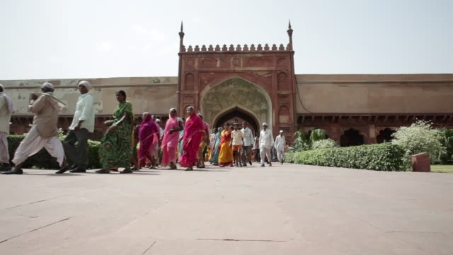LS Colorfully dressed Indians at Agra Fort / Agra, Uttar Pradesh, India