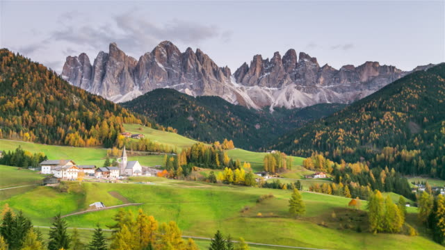Colors of Dolomites. Countryside view of the Funes valley St. Magdalena or Santa Maddalena view of the valley mountains, Bolzano Italy.