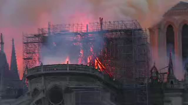 colossal fire has gutted the roof of notre dame cathedral in central paris causing a spire to collapse - pinnacle stock videos & royalty-free footage