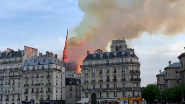 a colossal fire has swept through the famed notre dame cathedral in central paris causing a spire to collapse and raising fears over the future of... - spire stock videos and b-roll footage