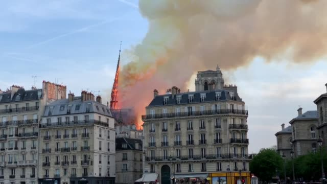 colossal fire has swept through the famed notre dame cathedral in central paris causing a spire to collapse and raising fears over the future of the... - pinnacle stock videos & royalty-free footage