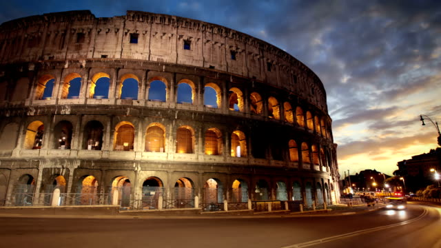 colosseum at dusk, rome, italy - rome italy stock videos and b-roll footage