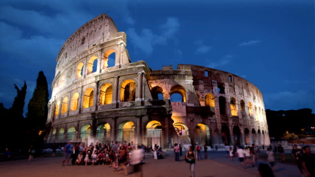 colosseum at dusk, rome, italy - colosseum rome stock videos and b-roll footage