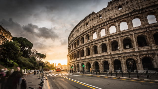colosseum in rome, italy at sunrise - rome italy stock videos & royalty-free footage