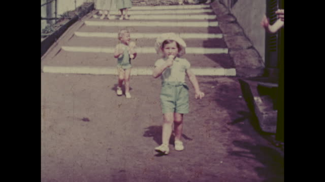 colour archive home movie footage of british holidaymakers enjoying the seaside resort of sandown on the isle of wight circa 1940s - old fashioned stock videos & royalty-free footage