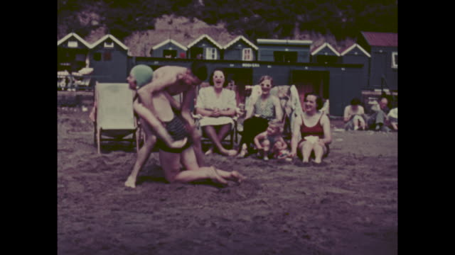 colour archive home movie footage of british holidaymakers enjoying the seaside resort of sandown on the isle of wight circa 1940s - healthy lifestyle stock videos & royalty-free footage