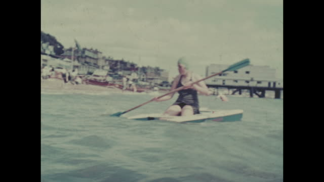 colour archive home movie footage of british holidaymakers enjoying the seaside resort of sandown on the isle of wight circa 1940s - swimwear stock videos & royalty-free footage