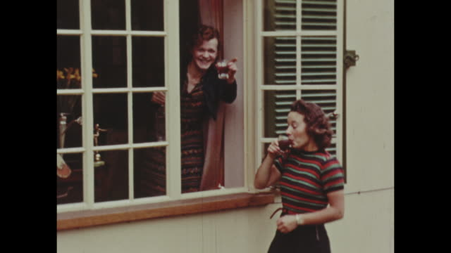 colour archive home movie footage of british home life circa 1940s - outdoors stock videos & royalty-free footage