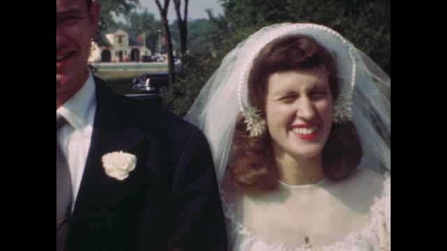 vídeos de stock, filmes e b-roll de colour home movie footage of a wedding in 1950s america - véu