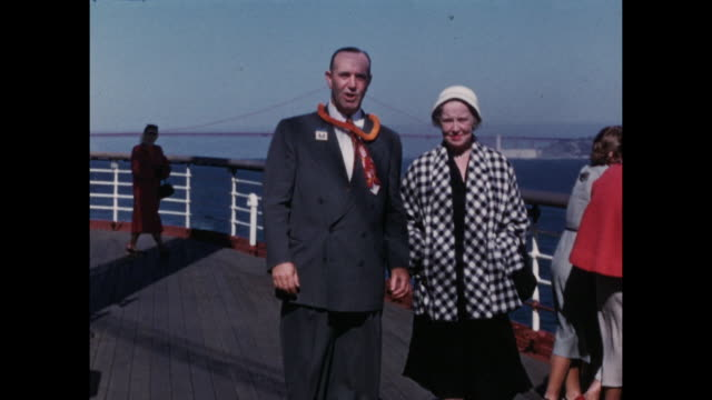 vídeos y material grabado en eventos de stock de colour home movie footage of scenes of american tourists on a cruise to hawaii including a group dance exercise class, swimming, and posing on the... - crucero vacaciones