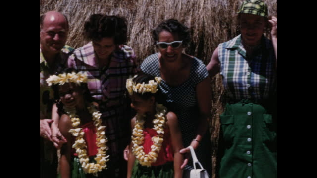 colour home movie footage of scenes of american tourists on vacation in hawaii including meeting local people watching hula dancing fishing on the... - hawaiianische kultur stock-videos und b-roll-filmmaterial