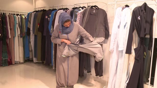 colourful and oozing defiance a sports friendly version of the abaya gown was once considered a symbol of cultural rebellion in conservative saudi... - jiddah stock videos & royalty-free footage
